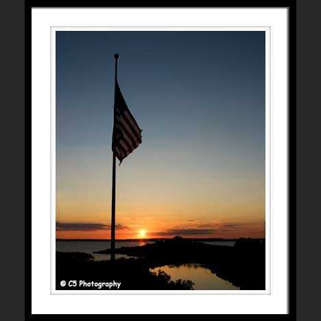 American Flag with Sunset over ocean
