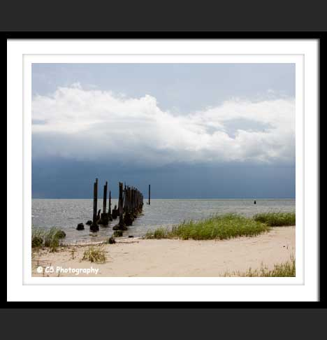 Photographs of Pier on sandy beach in Florida